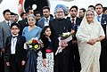 Manmohan Singh with the Prime Minister of Bangladesh, Mrs. Sheikh Hasina on his departure from Bangladesh to New Delhi, at Hazrat Shahjalal International Airport, in Dhaka, Bangladesh. Smt. Gursharan Kaur is also seen.jpg