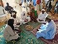 Marabouts citant la fatiah lors d'un baptême au Niger.jpg