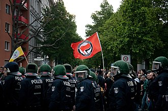 Antifaschistische Aktion - A demonstration by Antifaschistische Aktion on May Day 2014 in Berlin; Bereitschaftspolizei are in the foreground.