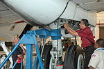 Mechanics work on Super Guppy Turbine's main landing gear (120503-F-JJ999-020).jpg
