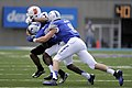 Members of the U.S. Air Force Academy (USAFA) football team tackle Idaho State Bengals' wide receiver Derek Graves as the USAFA Falcons defeated the Bengals 49-21 at Falcon Stadium in Colorado Springs, Colo 120901-F-ZJ145-606.jpg