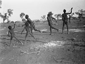 Indigenous Australians - Men and boys playing a game of gorri, 1922