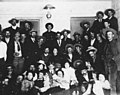 Men and women posed for group photograph inside a ballroom, Dawson, May 2, 1902 (AL+CA 7564).jpg