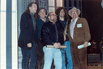 Pierre Cossette - Cossette (far right) posing with Michael Bolton, Kenny G and others in 1990
