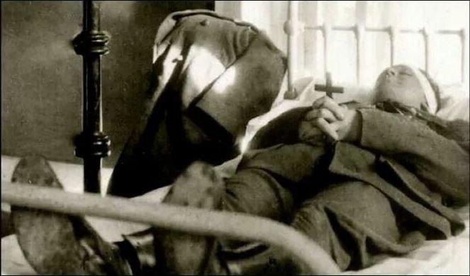 Michael Collins body lying in hospital