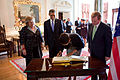 Michelle Obama Signs the Visitor Book at Farmleigh.jpg