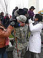 Military police officer in uniform assists lady climbing down from Washington Monument 2 Inauguration 2013.jpg