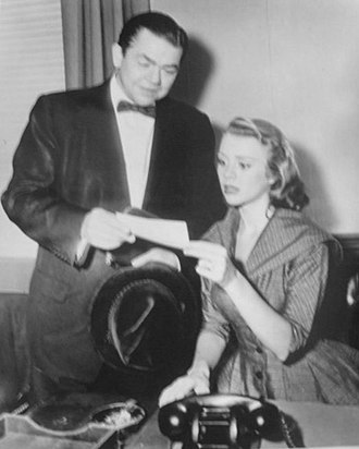 The Millionaire (TV series) - Michael Anthony (Marvin Miller) hands check to Betty Perkins (Inger Stevens) in a 1956 episode