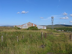 Ebbw Vale Steelworks - A mobile phone mast sits atop the trackbed of the former Rassa Railroad, extended to enable limestone to be moved from Cwar y Hendre to the iron and steel works at Ebbw Vale. Timber sleepers and some of the original stone sleepers can still be seen today along this bridleway