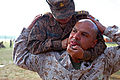 Mongolian Armed Forces Senior Sgt. M. Baigalmaa, top, brings U.S. Marine Corps Gunnery Sgt. Alexander Orellana to his feet using a pressure point technique during the Non-Lethal Weapons Executive Seminar (NOLES) 130820-M-MG222-007.jpg