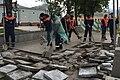 Moscow, Vozdvizhenka Street, destroying solid pavement with spades (30645492273).jpg