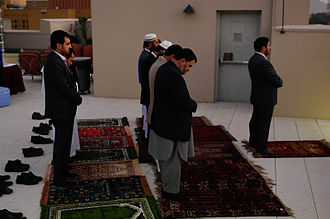 Five Pillars of Islam - Afghan politicians and foreign diplomats praying (making salat) at the U.S. Embassy in Kabul, Afghanistan.