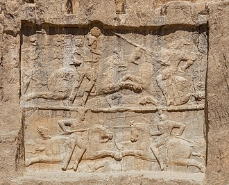 Carus - Panels at Naqsh-e Rustam, symbolizing the supposed victories of Bahram II over Carus (top) and Hormizd I Kushanshah (bottom).
