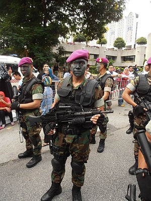 Heckler & Koch MG4 - MG4KE in the hands of Malaysian Navy PASKAL commando during 57th Malaysian National Day Parade.