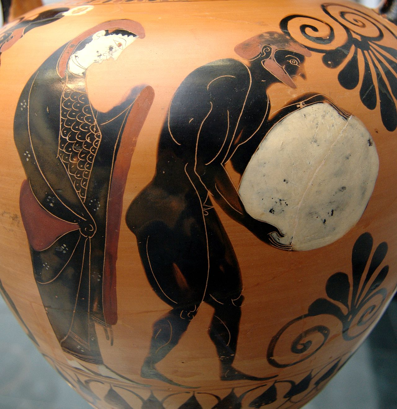 Sisyphus depicted on a black-figure amphora vase, with Persephone looking on