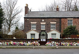 Ken Dodd - Oak House, Dodd's lifelong home, with floral tributes