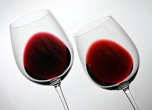 Oak (wine) - The effect of oak aging on two Penedès region Cabernet Sauvignon varietals, a two-year-old cosecha (left) and six-year-old crianza (right). As the wine matures, its color shifts from deep purple or crimson to a lighter brick-red, and takes on a more graduated appearance in the glass.