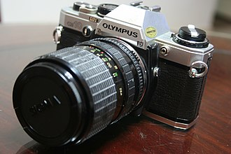 Olympus OM-10 - An Olympus OM-10 with a Sigma-brand lens