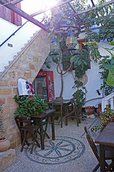 Outdoor café in Lindos, Rhodes.jpg