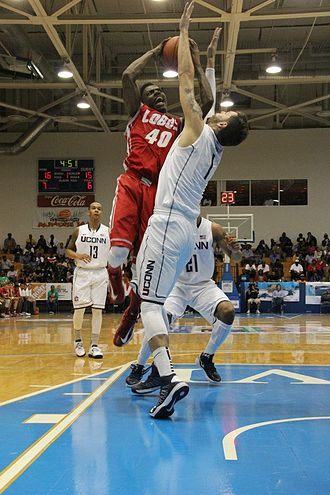 2012–13 Connecticut Huskies men's basketball team - UConn's Enosch Wolf defends against New Mexico's Demetrius Walker at the 2012 Paradise Jam Championship game