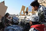 Paratroopers train National Police mechanics on vehicle maintenance DVIDS142789.jpg