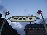 Paris art nouveau metro sign and lampposts.jpg