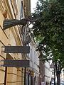 Pelican Room, bronze signboard. József Palotás work, 1987. A trombone blowing figure, with a bird (pelican). Baroque dwelling house facade detail ID 3852. - 15, Kossuth St., Downtown, Székesfehérvár.JPG