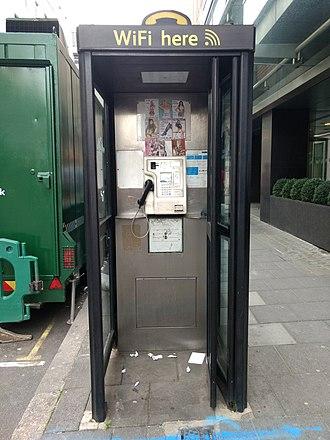 Tart card - Phone box with tart cards, London, 2017.