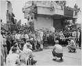Photograph of Gerald R. Ford and Other Crew Members Watching the Festivities to Honor King Neptune as the U.S.S.... - NARA - 187037.tif