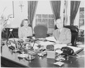 Photograph of President Truman and his secretary, Rose Conway, at the President's desk in the Oval Office. - NARA - 199487.tif