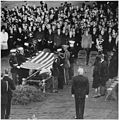 Photograph of servicemen removing the flag from the casket of President John F. Kennedy at Arlington National... - NARA - 200452.jpg