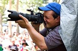A photographer at the Calgary Folk Music Festival