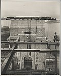 Photographer perched on ironwork of Sydney Harbour Bridge, 1932 (8282702997).jpg
