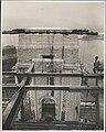 Photographer perched on ironwork of Sydney Harbour Bridge, 1932 (8282702997).jpg