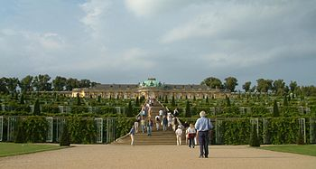 The south facing garden façade. Frederick the Great ignored his architect's advice to place the piano nobile upon a low ground floor. As a result, the palace failed to take maximum advantage of its location. Its windows are devoid of views, and seen from its lower terraces it appears to be more of an orangery than a palace.