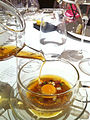 Pouring mock turtle soup (with disolved pocket watch) (7164137203).jpg