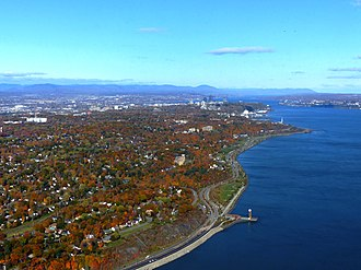 Quebec City - The Promontory of Quebec at the narrowing of the Saint Lawrence River and surrounded by the Laurentian Mountains.