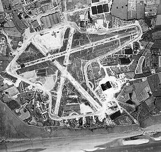 Warton Aerodrome - Aerial photograph of Warton airfield, the main runway runs NE/SW, hangars and technical buildings are to the southeast, 10 August 1945.
