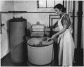 "REA, ""Woman turning the nozzle"" - NARA - 195877.tif"