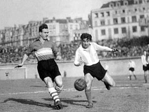 Racing Club de France football Colombes 92 - Racing (in dark jersey with horizontal stripes) playing Argentine Racing Club in Parc des Princes, 1950.
