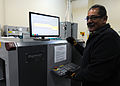 Renaldo Hernandez, with the 50th Logistics Readiness Flight, X-rays a package for illegal items at the secure area logistics facility at Schriever Air Force Base, Colo 130115-F-OT300-328.jpg