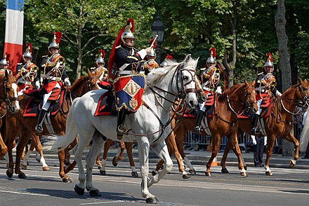 Mounted members of the French Republican Guard Band, a fanfare band during Bastille Day in 2013. Republican Guard Bastille Day 2013 Paris t113139.jpg