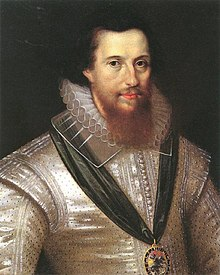 A portrait of Robert Devereux, who is portrayed wearing a silver shirt.  He has shoulder-length black hair and a brown beard which reaches down to his collar.  Devereux is wearing a medal suspended from a green ribbon.