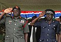 Robert S. Ferrell and Gambian officers saluting (cropped).jpg