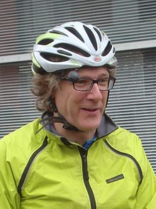 Portrait of a man wearing a bike helmet