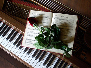Rose-on-music-book-on-piano.jpg