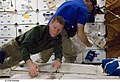 S125-E-006489 - Gregory C. Johnson helps with unpacking chores during STS-125.jpg