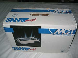 SAM Coupé - The original MGT SAM Coupé box — all original MGT material pictured a single disk drive inserted into the right hand side even though the machine required single drive users to use the left hand bay.