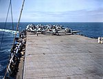 SBD, F6F and TBF aircraft are respotted for take off on a escort carrier c1943.jpg