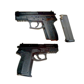 """SIG Pro - A SP 2022 issued to the French National Police. The words """"PROPRIETE DE L'ETAT"""" (""""Property of the State"""") are apparent on the front of the slide, on the right side (bottom)."""